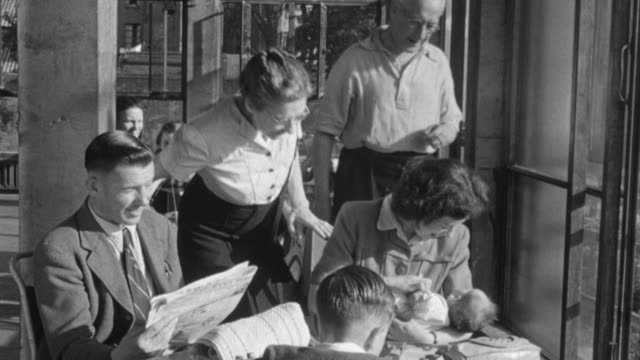 1948 montage members welcoming new baby to the pioneer health center in peckham / london, england - peckham health centre stock videos & royalty-free footage