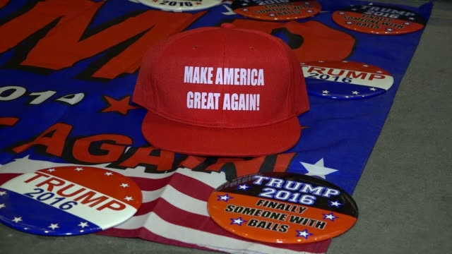 memorabilia – propaganda being sold across the street from the hilton midtown hotel where donald trump awaited the results of the presidential... - election stock videos & royalty-free footage