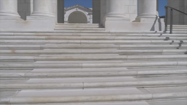 memorial amphitheater in arlington national cemetery during springtime, washington dc, united states of america, north america - 死傷者点の映像素材/bロール