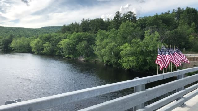 memorial bridge and flags crossing the androscoggin river in peru, maine - operation enduring freedom stock videos & royalty-free footage