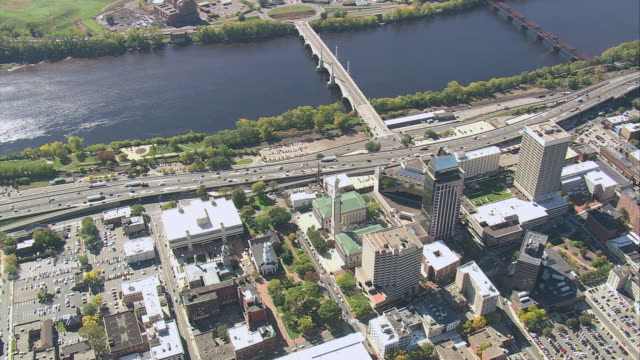 aerial memorial bridge over connecticut river bisecting downtown business district / springfield, massachusetts, united states - springfield massachusetts stock videos & royalty-free footage