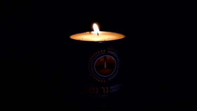 memorial candle light in the dark