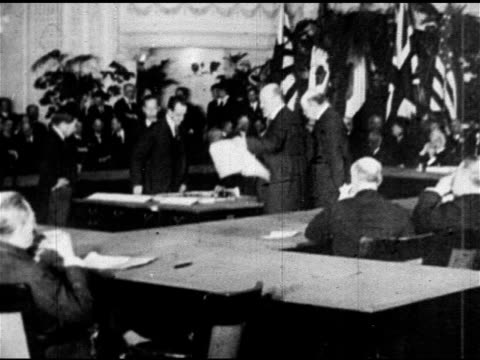 stockvideo's en b-roll-footage met memorial continental hall w/ meeting in session xws men handing papers to seated asian male signing papers of treaty - 1921