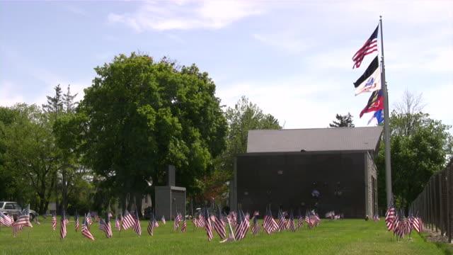 memorial day. american flag & culture. war cemetery. honor, patriotism. - war memorial stock videos & royalty-free footage