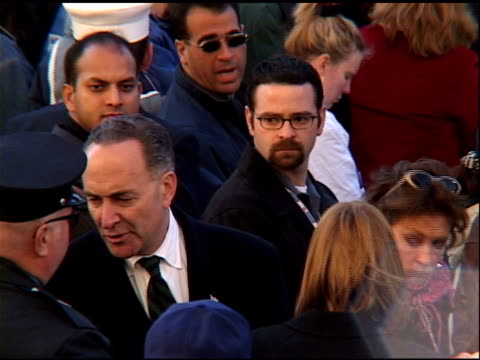 WTC Memorial Ground Zero NYC October 28 2001 NY Senator Charles Schumer listening to Renee Fleming performing in service turning to talk to...