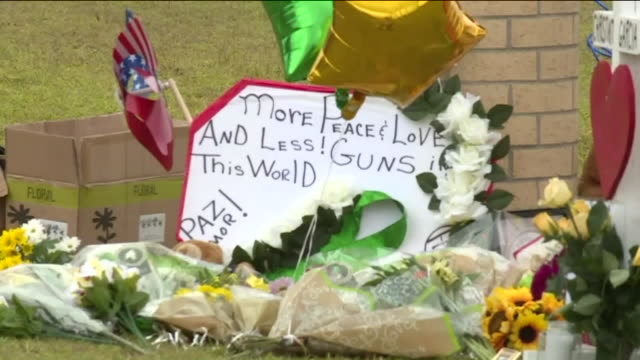 memorial grows outside santa fe high school as community mourns loss of eight students, two teachers. - mourning stock videos & royalty-free footage