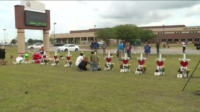 KIAH Memorial Grows Outside Santa Fe High School As Community Mourns Loss of Eight Students Two Teachers