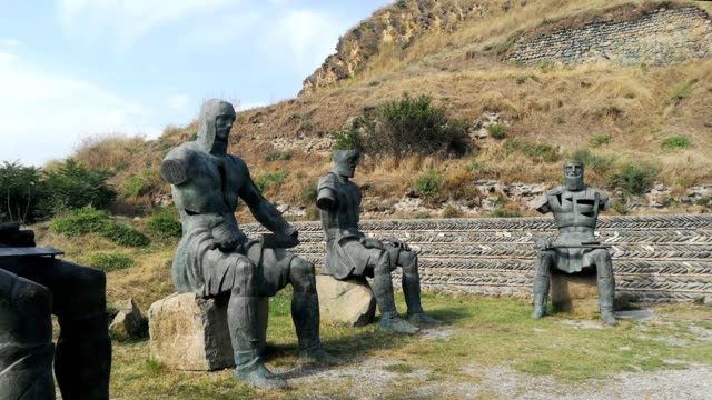 memorial of georgian warriors in the front of gori fortress in gori, georgia. - ジョージア調点の映像素材/bロール