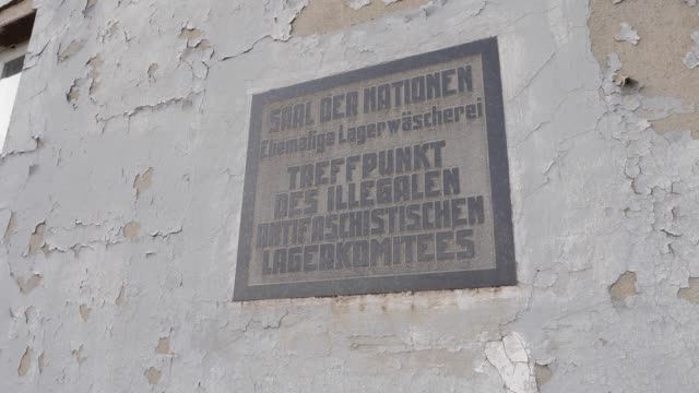 memorial plaque at the former camp laundry with the inscription hall of nations meeting point of the illegal antifascist camp committee at the... - washing stock videos & royalty-free footage
