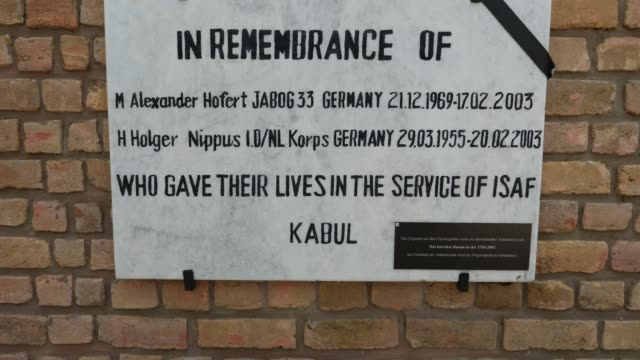 memorial plaque for a fallen soldier in the ehrenhain who was picked up from kabul the forest of remembrance near potsdam unites the ehrenhaine of... - memorial plaque stock videos and b-roll footage