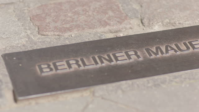 'berliner mauer 1961-1989' memorial plaque on roadside where the berlin wall placed / berlin, germany - symbols of peace stock videos & royalty-free footage