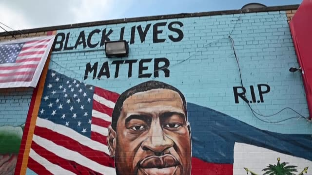 memorial portrait of george floyd, who was killed in may during an arrest, is unveiled in brooklyn in presence of his brother - paintings stock videos & royalty-free footage