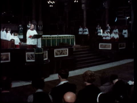 memorial service for bing crosby england london westminster ts pan congregation cms side illtyd harrington ts pan over service singing cs canon... - congregation stock videos & royalty-free footage