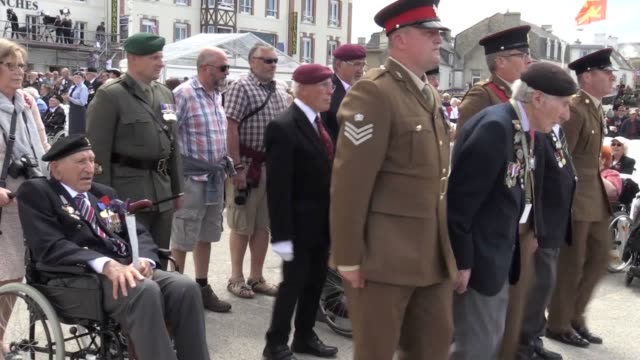 a memorial service parade and military flypast is held in the town of arromanches to mark the 75th anniversary of the dday landings - d day stock-videos und b-roll-filmmaterial