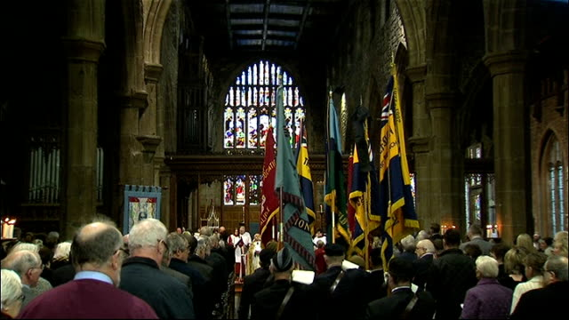 memorial services held across country held for six soldiers killed in afghanistan; england: south yorkshire: halifax minster: int military flags... - choir stock videos & royalty-free footage