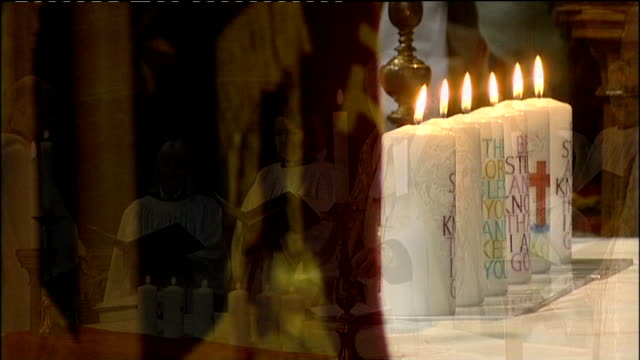 memorial services held across country held for six soldiers killed in afghanistan; vicar lighting candles **names of dead soldiers being read out... - minister clergy stock videos & royalty-free footage