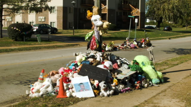 Memorial setup on the spot in the street where Michael Brown's body lay after he was shot by a police officer on August 9 2014