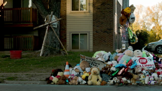 memorial setup on the spot in the street where michael brown's body lay after he was shot by a police officer on august 9 2014 - missouri stock videos & royalty-free footage