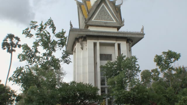 ms tu memorial stupa against stormy sky, choeung ek, cambodia - cambodia stock videos and b-roll footage