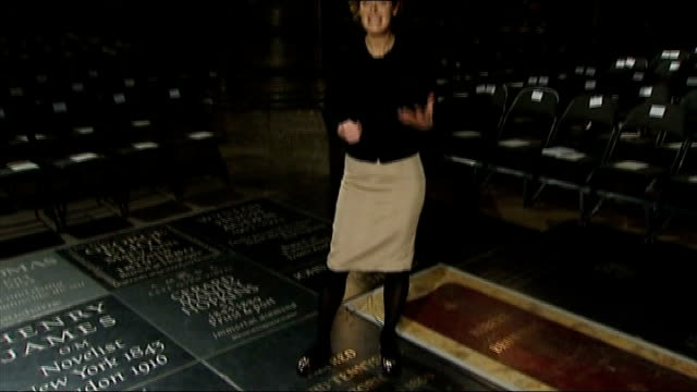 memorial to poet ted hughes unveiled in westminster abbey; westminster abbey: 'ted hughes' memorial stone tilt up reporter to camera across memorial... - poet stock videos & royalty-free footage