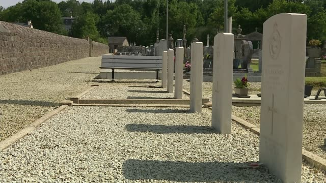 memorial to raf pilots unveiled in northern france france normandy saint sever military cemetery and headstones french village skyline flags normandy... - grab stock-videos und b-roll-filmmaterial
