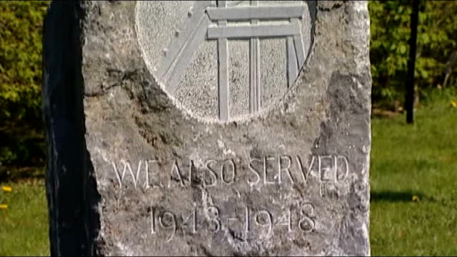 staffordshire national memorial arboretum ext 'we also served' inscription on bevin boys memorial - 彫刻画点の映像素材/bロール