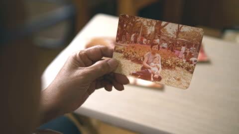 minnen fotoalbum - fotografi konst och konsthantverksföremål bildbanksvideor och videomaterial från bakom kulisserna