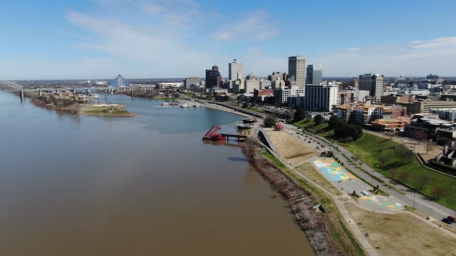 memphis, tn, u.s. - drone views of cityscape along mississippi river, on thursday, march 5, 2020. - memphis tennessee stock videos & royalty-free footage