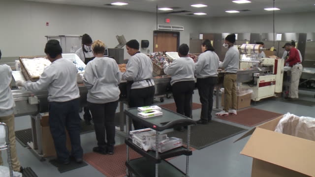 wreg memphis tn us workers handling food in the central nutrition center which houses the division of nutrition services which is responsible for the... - special education stock videos & royalty-free footage