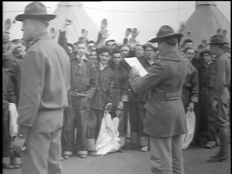 men accepted into the civilian conservation corps taking oaths and entering cabins / united states - 1934 stock videos & royalty-free footage