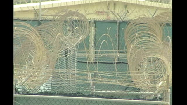 Men accused of planning 9/11 attacks plead guilty at Guantanamo Bay pretrial hearing Barbed wire fences around Camp Delta prison camp