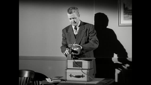MS Men adjusting projector / United States