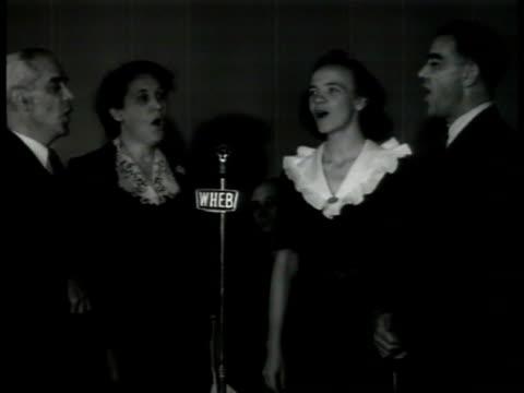 men amp women singing 'jingle bells' at microphone winter holiday christmas xmas santa claus spirit chorus choir theme cheer new hampshire - hampshire england stock videos & royalty-free footage