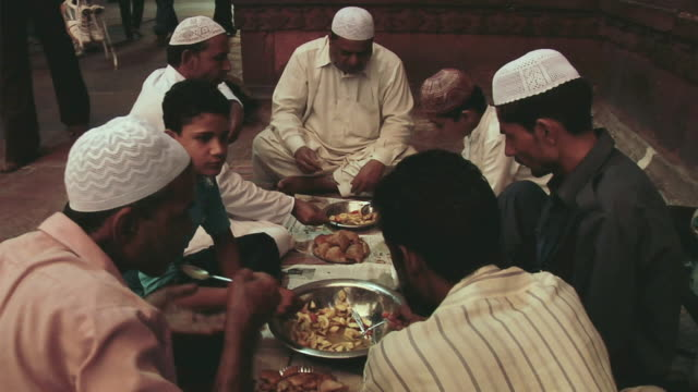 ms men and boys doing iftaar in holy month of ramzan / delhi, india - dischdascha stock-videos und b-roll-filmmaterial