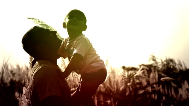 Men And Child  Playing Silhouette