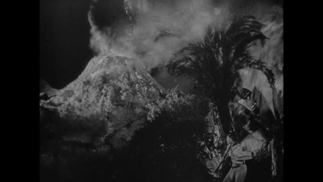 1925 men and dinosaurs are disoriented in the smoke and fire of erupting volcano - 1925 stock videos & royalty-free footage