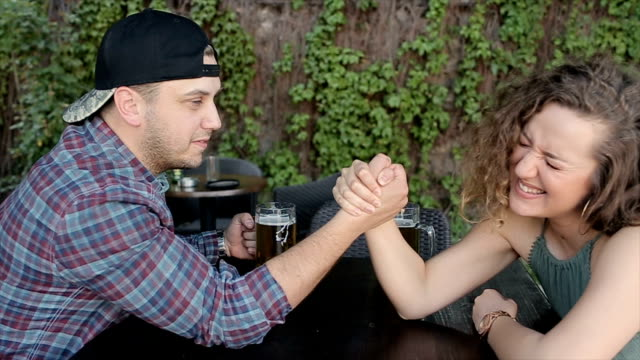 men and woman friendship  arm wrestling,woman winning - bicep stock videos and b-roll footage