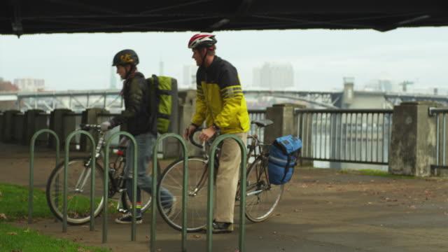 ws men and woman riding bicycles / portland, oregon, usa - portland oregon bike stock videos & royalty-free footage