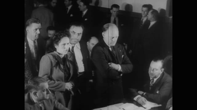 stockvideo's en b-roll-footage met men and women arraigned before judges - bewegingsbeperkende middelen