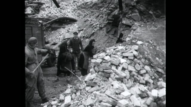 men and women clear bomb damage in central berlin; 1949 - ruined stock videos & royalty-free footage