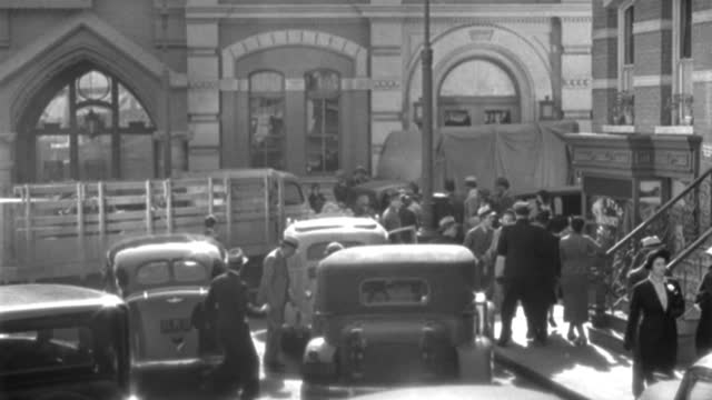 men and women congregate at the scene of an automobile accident in 1937. - 1937 stock videos & royalty-free footage