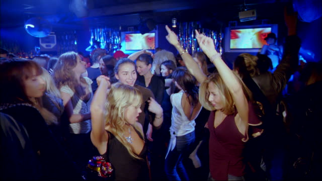 men and women dance at a crowded nightclub. - russland stock-videos und b-roll-filmmaterial