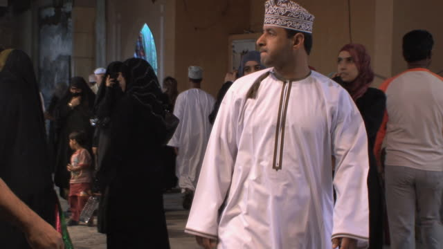 MS Men and women entering Mutrah souq, Muscat, Oman