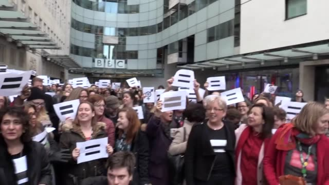 bbc men and women gather outside their offices to highlight their support for equal pay on international women's day interview with journalist carrie... - uguaglianza video stock e b–roll