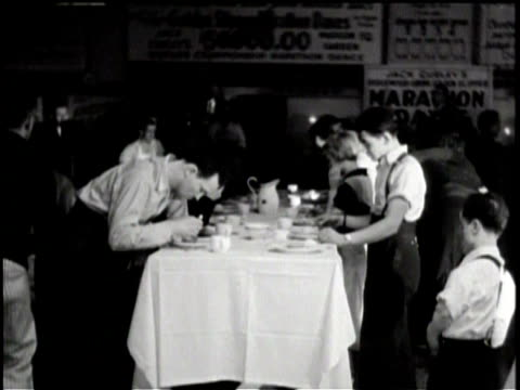 men and women getting picked up out of beds by nurses / silhouette of a woman getting a massage / men and women dancing at a table while they eat / - massage table stock videos & royalty-free footage