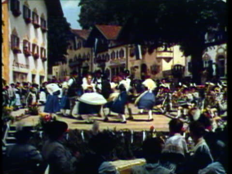 1953 WS MS PAN Men and women in traditional German costumes folk dancing at festival / Munich, Germany / AUDIO