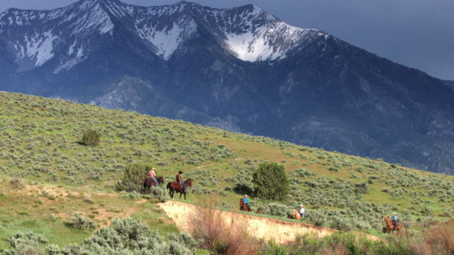 Men and Women in Western Wear Riding Horses Through Gorgeous Utah Valley