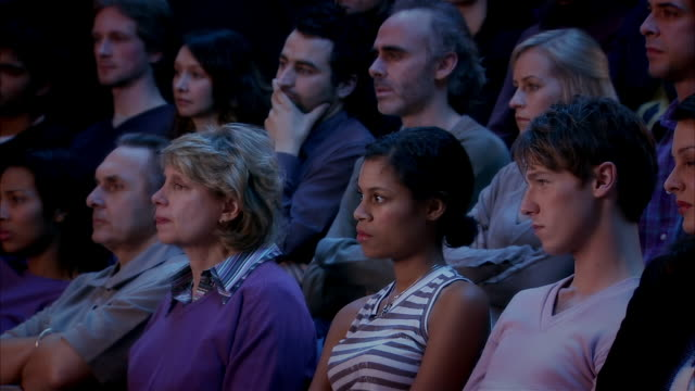 men and women intensely watching movie in theatre - studio shot stock videos & royalty-free footage
