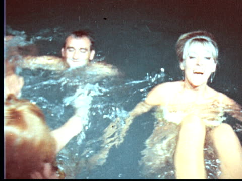 1966 montage men and women laughing playing and splashing in pool at night / hamilton, bermuda - 1966 stock videos and b-roll footage