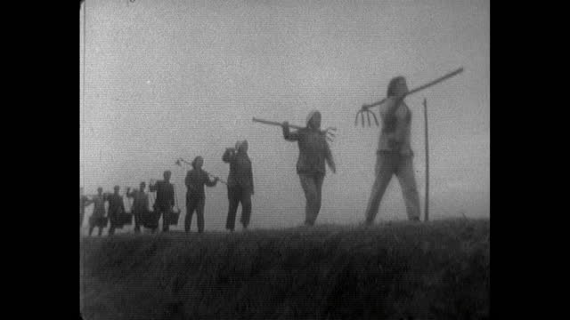 men and women march to work in field carrying tools; 1964 - communism stock videos & royalty-free footage